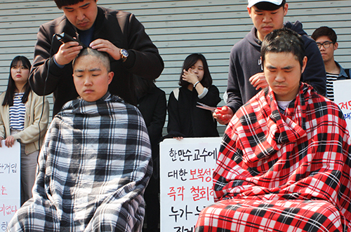 Shaving Chairpersons' Head to Oppose the School's Accusation against Students